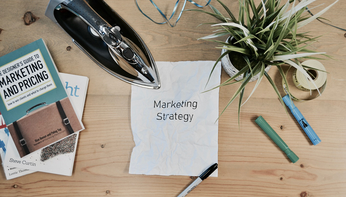 Marketing Strategy written on a piece of paper placed on a table