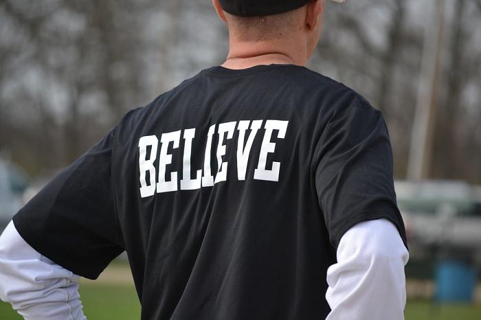 man wearing black shirt believe